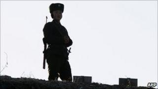 North Korean soldier on watch on the banks for the Yalu River, across the border from China on 26 November 2010