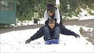 Young people playing in snow