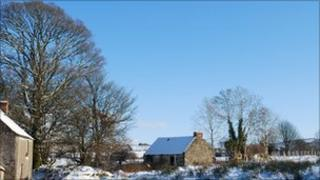 Ruined cottage in snow