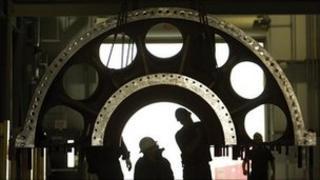 Men inspecting a turbine