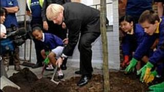 London Mayor Boris Johnson along with pupils from Kings Avenue Primary School helps to plant a tree in Brixton