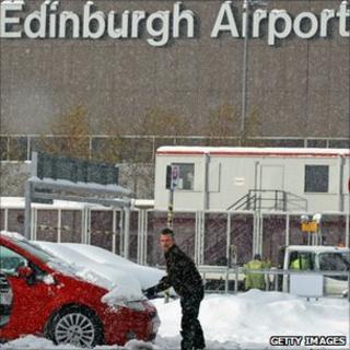 Man digs car out at Edinburgh Airport
