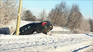 Car in a ditch on Sir Walter Scott Drive, Inverness
