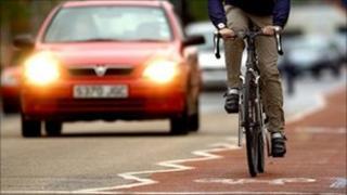 Man cycling in a bike lane