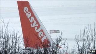 Snow-covered Easyjet tail