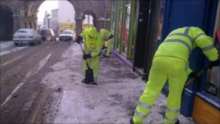 Clearing icy pavements, Ferryquay St, Derry