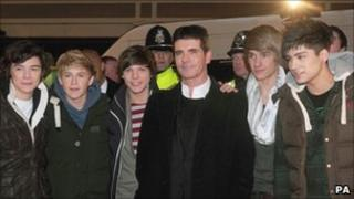 One Direction and Simon Cowell arriving in Wolverhampton