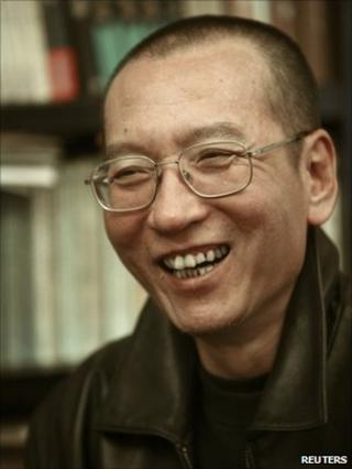Chinese dissident Liu Xiaobo smiles in this undated photo released by his family