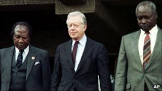 Robert Ouko (left), ex US President Jimmy Carter (c) and President Moi (right)