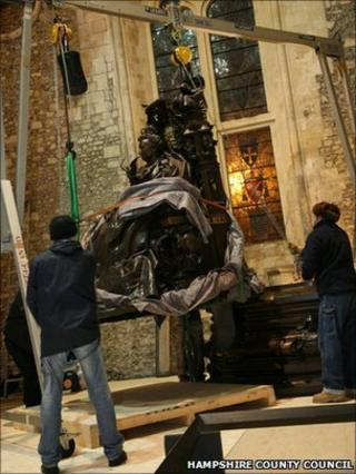 Statue being winched