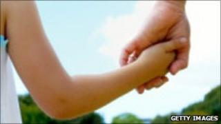 File photo of child holding parent's hand