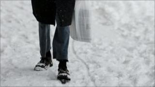Elderly man walking in snow