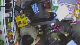 Robber stealing from till