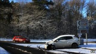 A car left abandoned in the snow on Parkway near Ironbridge, Telford.