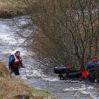 Rescue teams and the upturned quad bike
