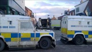 Police vehicles block off the area around Stratheden Street