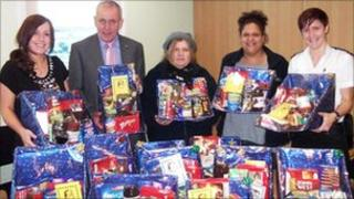 Prison staff with Christmas hampers