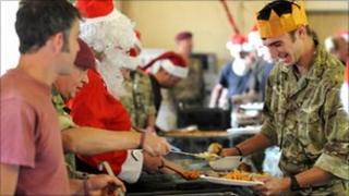 Soldiers in Afghanistan having Christmas dinner in 2010