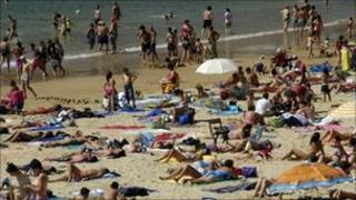Sunbathers on a beach at San Sebastian in the Basque country, Spain