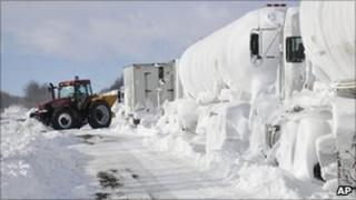 Snow plough clearing closed highway in Canada
