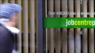 A woman walks past a job centre in Glasgow