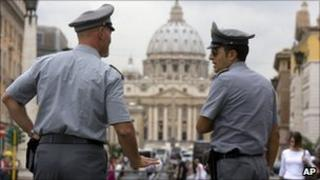 File picture of Italian financial police officers in front of St Peter's Basilica in Rome