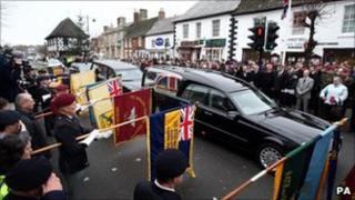 Mourners in Wootton Bassett watch the hearse carrying Cpl Steven Dunn's coffin