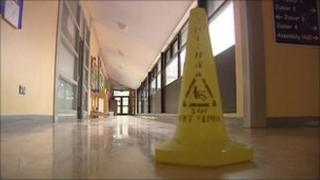 Yellow warning cone on corridor