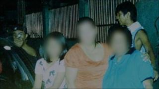 Photograph taken by Reynaldo Dagsa, edited to prevent identification of family members