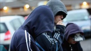Youths in hooded tops