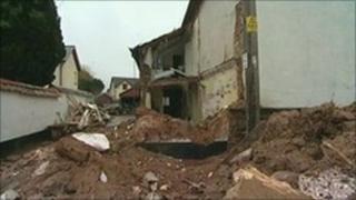 Collapsed cob cottage