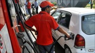 A petrol station employee fills up a car in Karachi, Pakistan (file)