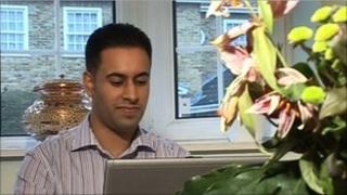 Dev Chana trading shares on his home computer