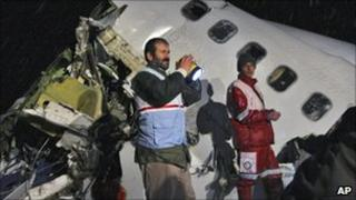 Rescue workers attend the scene after an IranAir Boeing 727 passenger plane crashed outside the city of Orumiyeh, northwest of the capital, Tehran, Iran, Jan. 9, 2011.