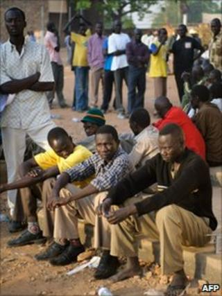 Southern Sudanese men queue outside the University of Juba polling centre