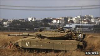 An Israeli tank near the border along the northern Gaza Strip, 8 January