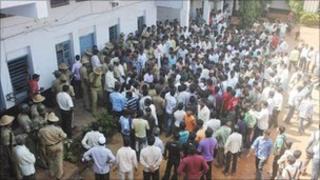 Crowd outside the New English School in Karnataka