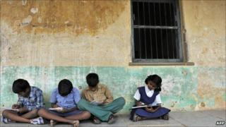 Indian school children outside a classroom at a government primary school in Hyderabad