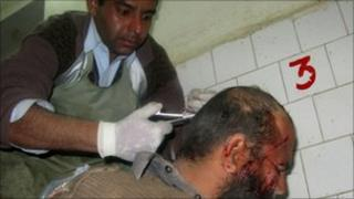 An injured Pakistani paramilitary soldier is treated at a hospital in Bannu on 12 January 2011