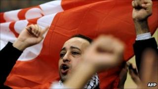 People demonstrate on January 13, 2011 in Paris, to protest against the repression against demonstrators in Tunisia.