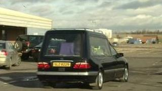 The coffin of Michaela McAreavey leaves Belfast City Airport in a hearse on Friday