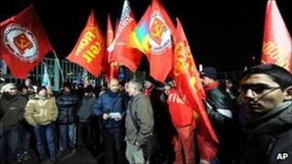 Fiat workers gather outside of the Mirafiori factory in Turin, 14 January