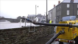Flood defences at the Pont Fawr Bridge, Llanwrst, on Saturday Photo: Environment Agency