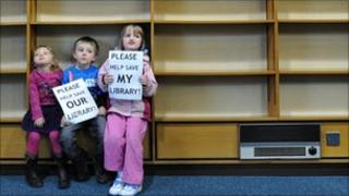 Children with empty library shelves