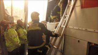 Firefighters helping the trapped man
