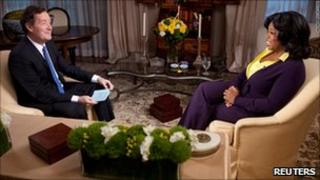 Piers Morgan (l) interviewing Oprah Winfrey (r)
