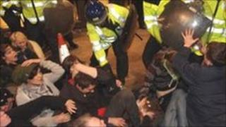 Protesters clash with police near the Royal Bank of Scotland