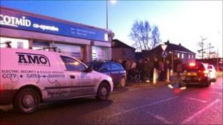 Queue of people at ATM in Fintry Road, Dundee