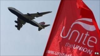 BA plane flies past a Unite flag