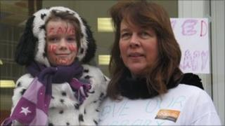 Campaigner Jenny Carey-Wood and her daughter Freya, seven, celebrate the library being allowed to stay open